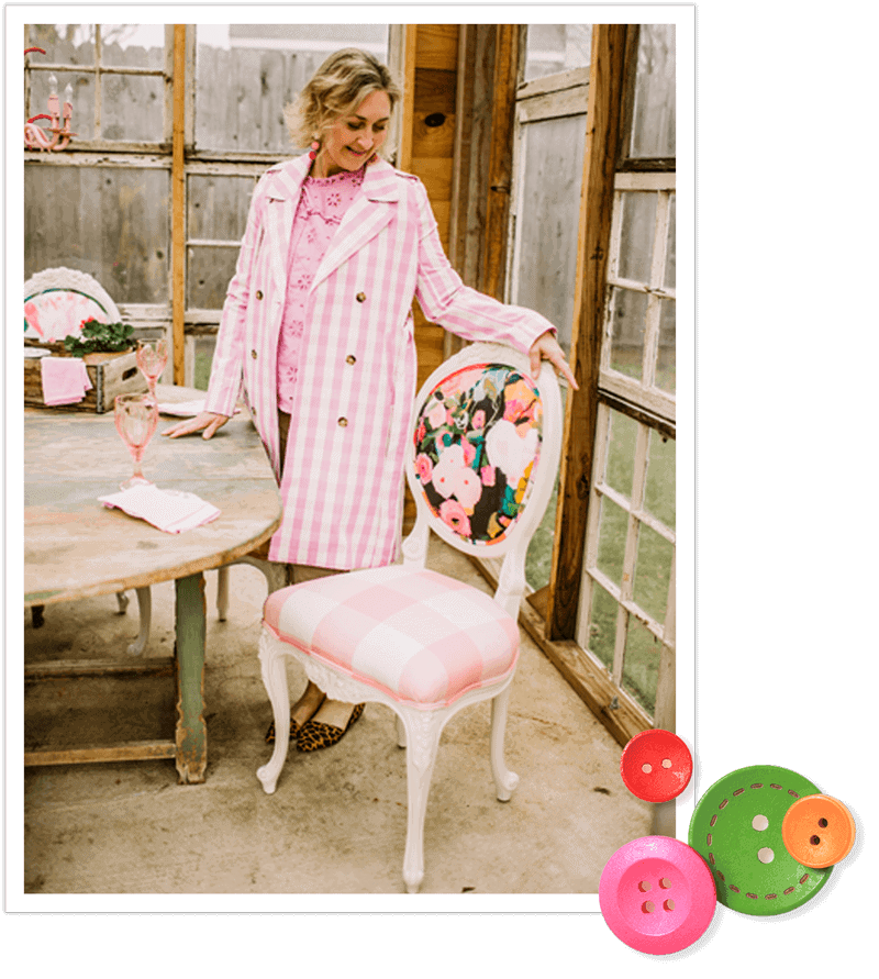 Wendy Conklin in jacket with chair